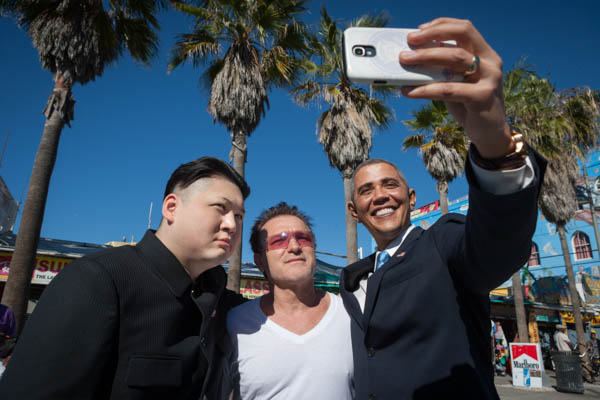 January 23, 2015. Los Angeles, California.  US President Barack Obama gives North Korea's leader Kim Jong-Un a personal tour around Los Angeles... or rather Howard (doesn't reveal his surname), the world's first Kim lookalike and Reggie Brown, the world's number one Obama impersonator, meet during Howard's first trip as Kim to the US. The lookalike duo visited the famous Hollywood Sign, Sony Pictures studio and Venice Beach. Howard and Reggie are pictured with top Bono lookalike, Pavel Sfera. Photo copyright John Chapple / www.JohnChapple.com / www.facebook.com/johnchapplephotography